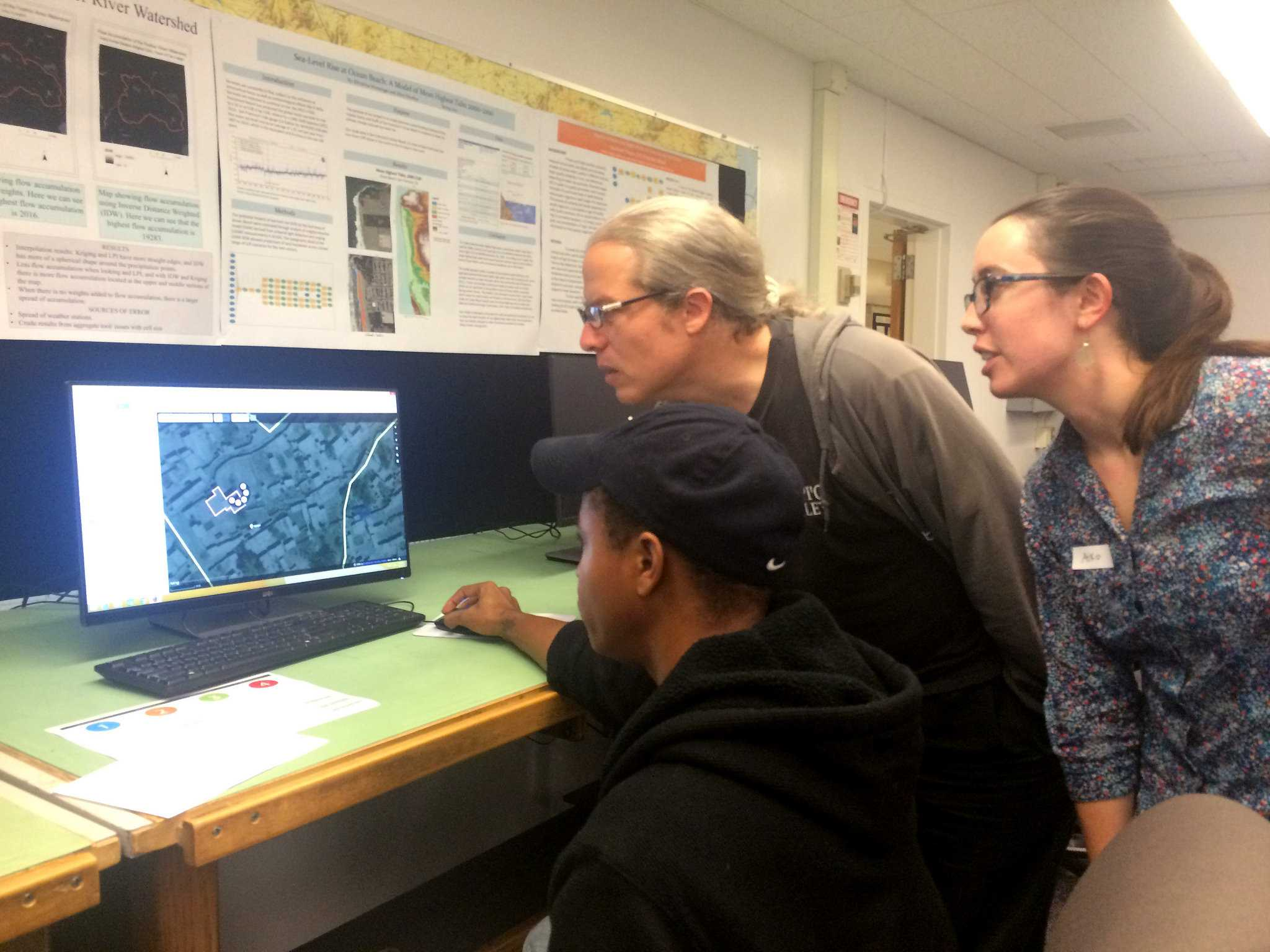 (right to left) Rah Smith, urban studies and planning major, Ben Discoe, mapping instructor, and Aiko Weverk, IGIS associate director explore different applications of crowd-mapping at the Institute for Geographic Information Science's first marathon at SF State Wednesday Nov. 18, 2015. (Brian Grabianowski / Xpress)