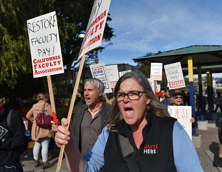 Faculty members organized by CFA march on the sidewalk of 19th Avenue during the protest at SF State Tuesday, Nov.17, 2015. (Qing Huang / Xpress)