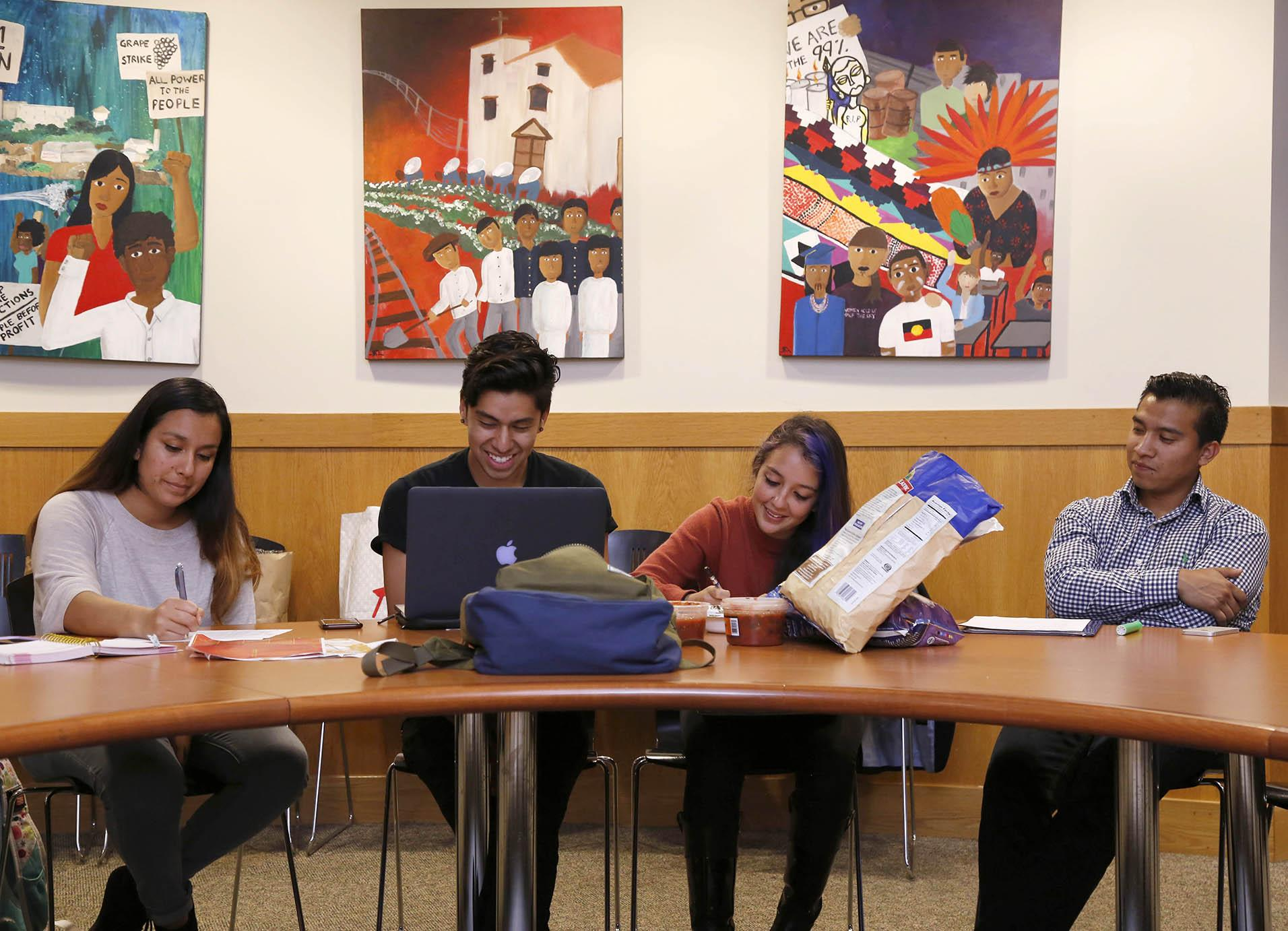 (left to right) Janet Lopez-Galindo, Miguel Castillo, Pamela Ortiz and Ramese Orta prepare for the UndocuWeek event occurring on Nov. 16 to 20 during their weekly IDEAS meeting Wednesday Oct. 28, 2015. (Emma Chiang / Xpress)