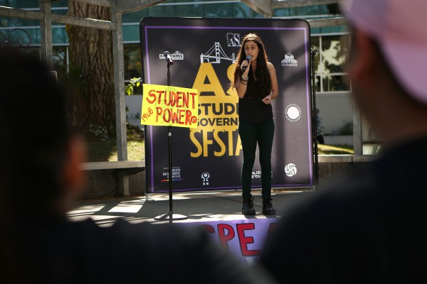SF State Real Food Challenge member Celia LoBuono Gonzalez, a third year communications and geography major, speaks about pouring rights during the 'Speak Out' rally in Malcom X Plaza on Tuesday October 20, 2015. (Photo by Joel Angel Juárez / Xpress)