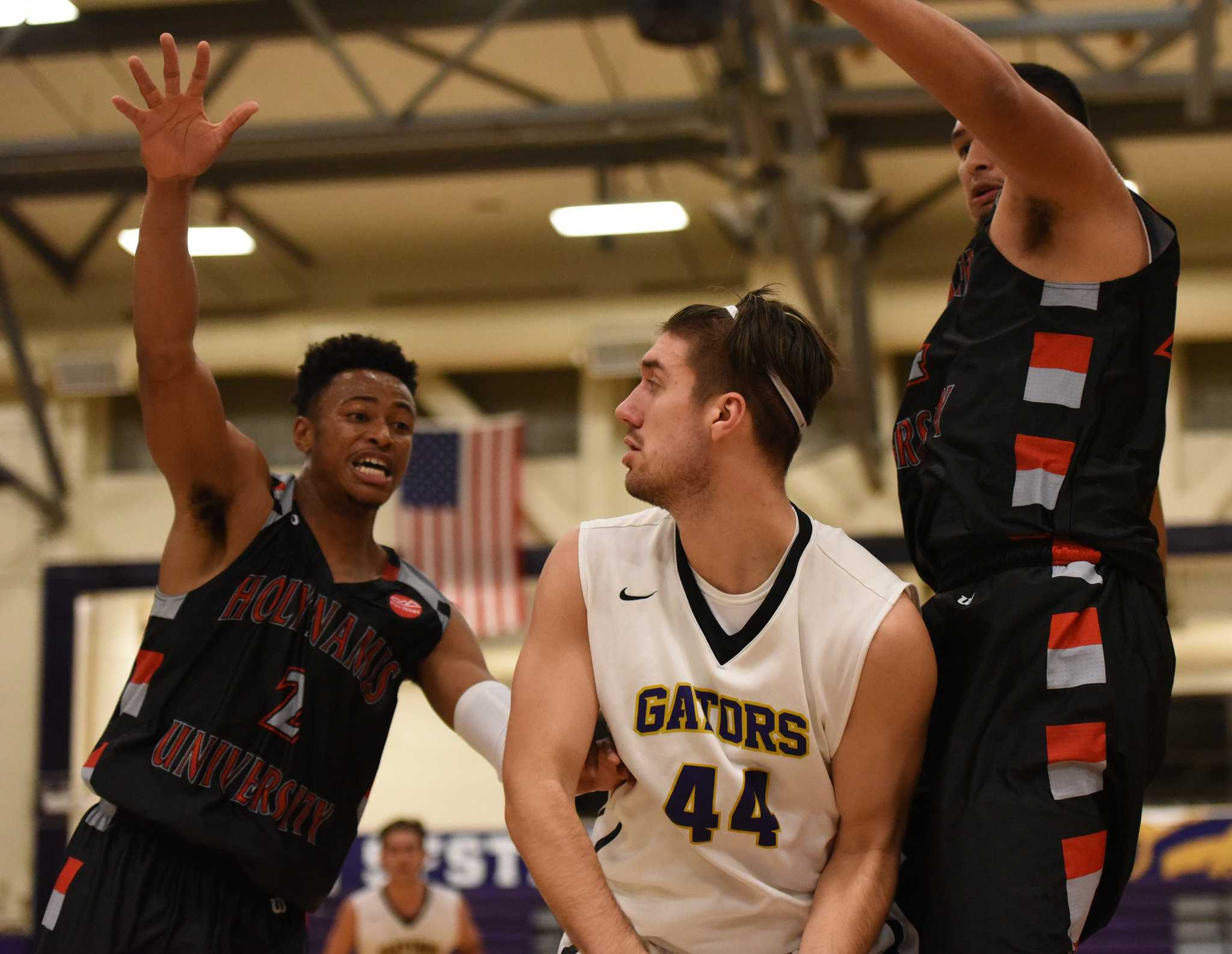 SF State Gators forward Damien Rance (44) protects the ball as he looks to pass in a game against the Holy Names Hawks at The Swamp Gymnasium Tuesday, Nov. 24. (David Henry / Xpress)