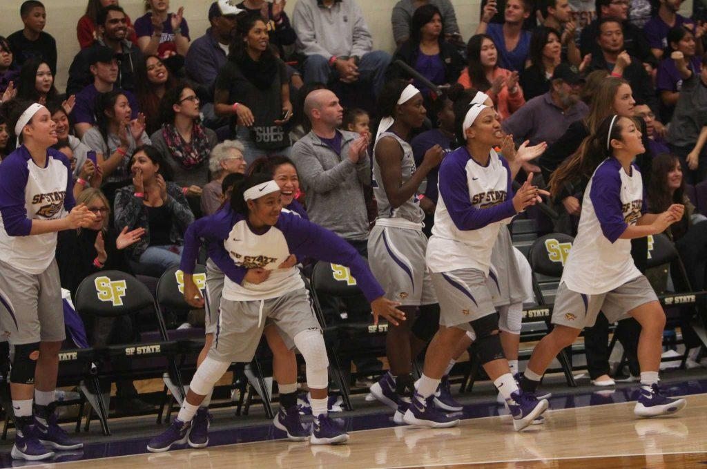 Team members of the SF State Gators women's basketball team run to the court after defeating the Chico State Wildcats in the Gymnasium Friday, Dec. 4, 2015. (Xpress/Kofman)
