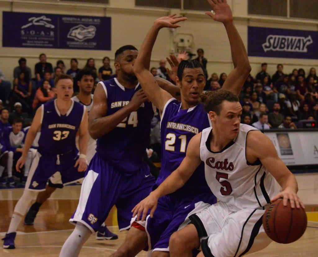 SF State Gators Floyd Wormley (24) and Brantley Bynum (21) try to steal the ball from Chico State's Robert Duncan (5) during the men's basketball game at the Swamp Gymnasium Friday, Dec. 4, 2015. SF State lost 67-74. (Melissa Minton/ Xpress)