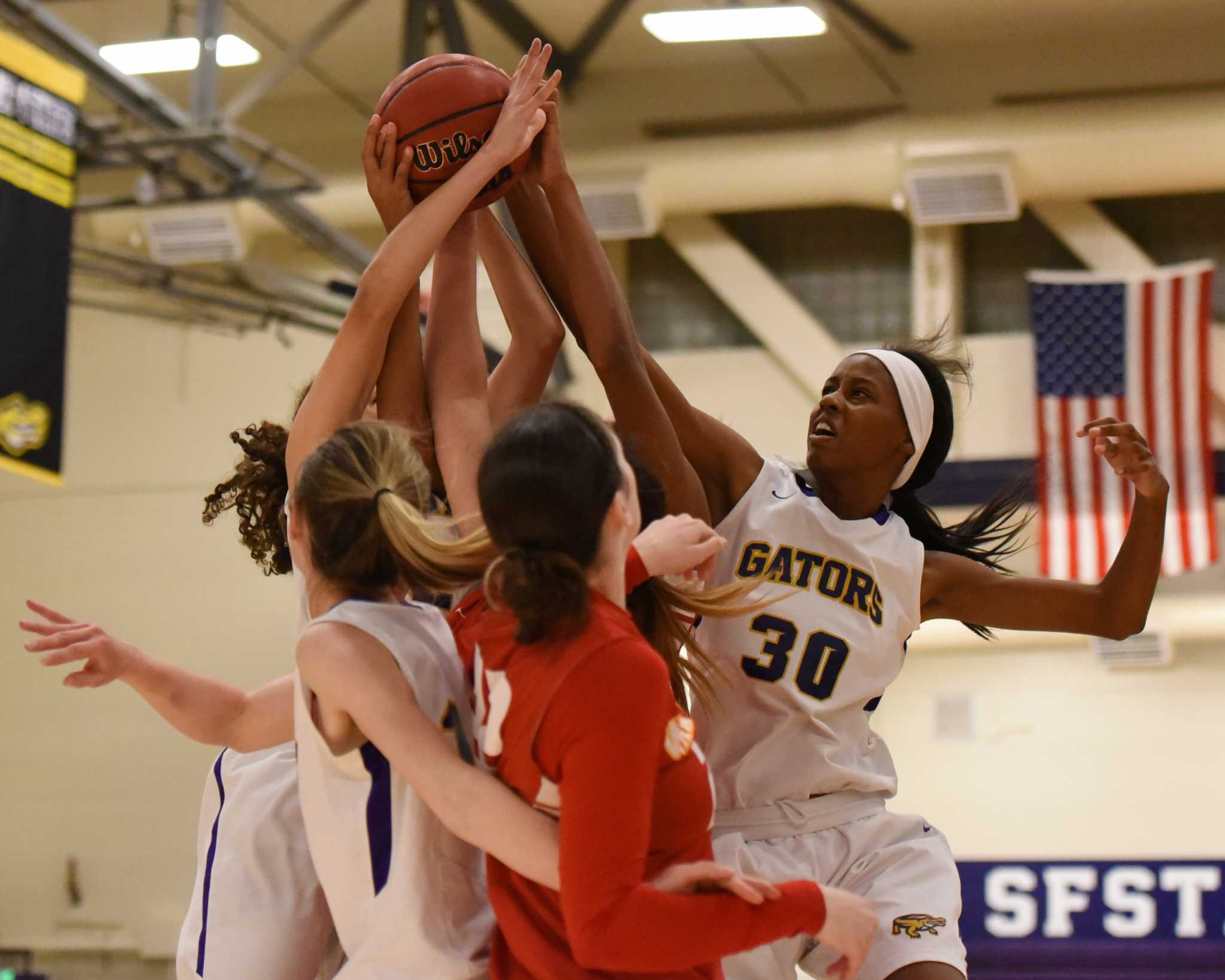 SF State Gator Kiara Ginwright fights for a rebound as the Gators face the Stanislaus State Warriors at The Swamp Gymnasium Saturday, Dec. 5. (David Henry / Xpress)