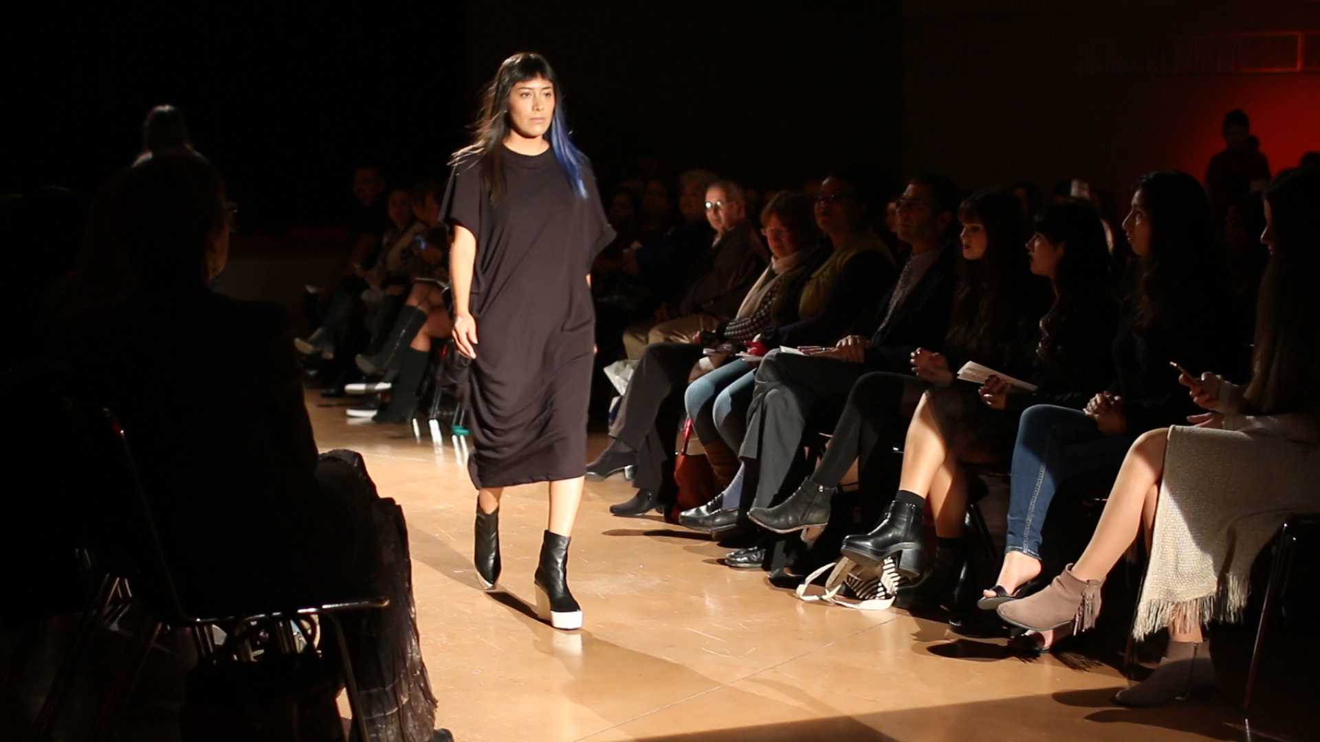 SF State fashion designer major Lia Herrera walks down the runway at the annual fashion show themed