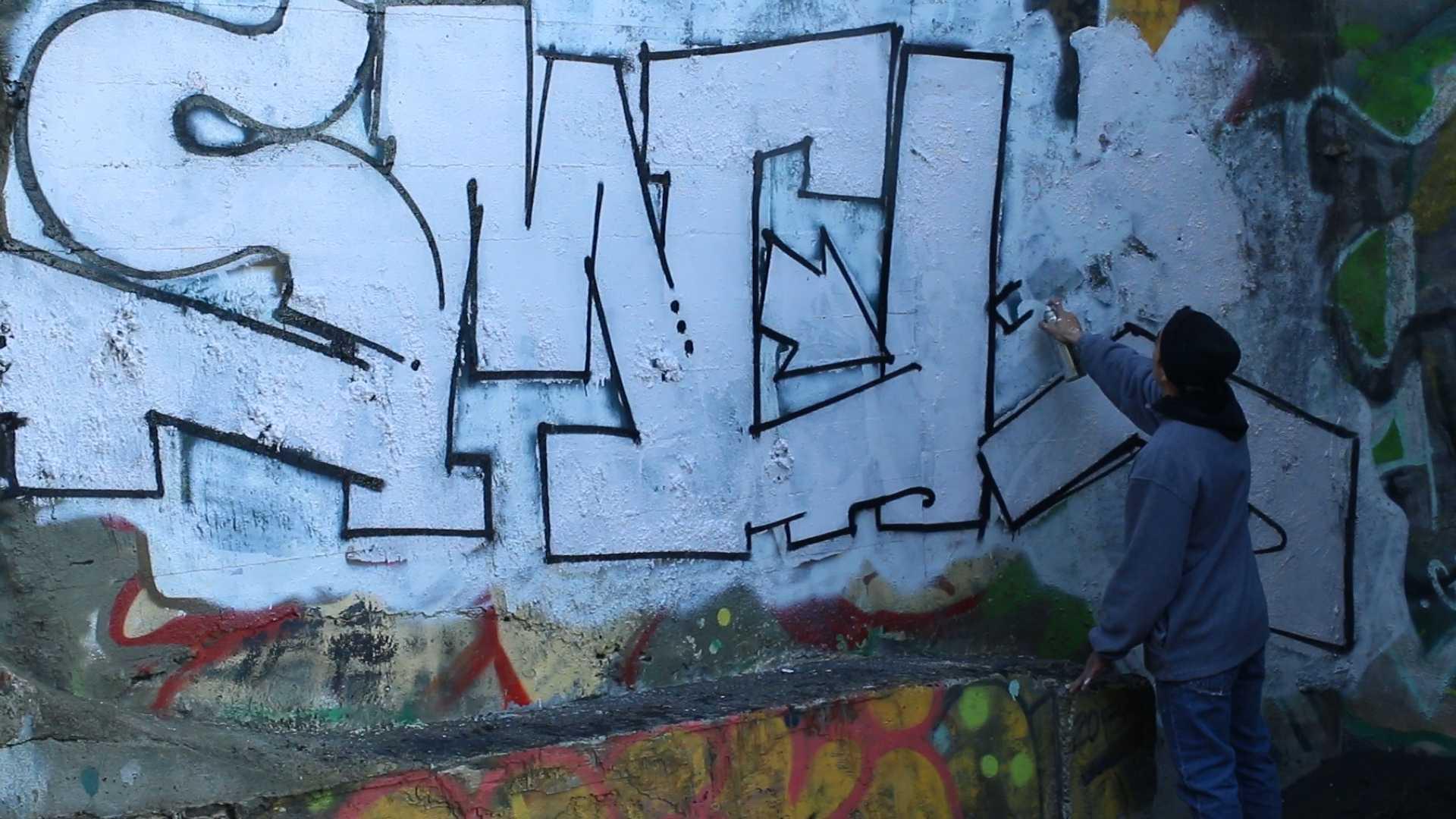 Graffiti artists define the line between art and vandalism