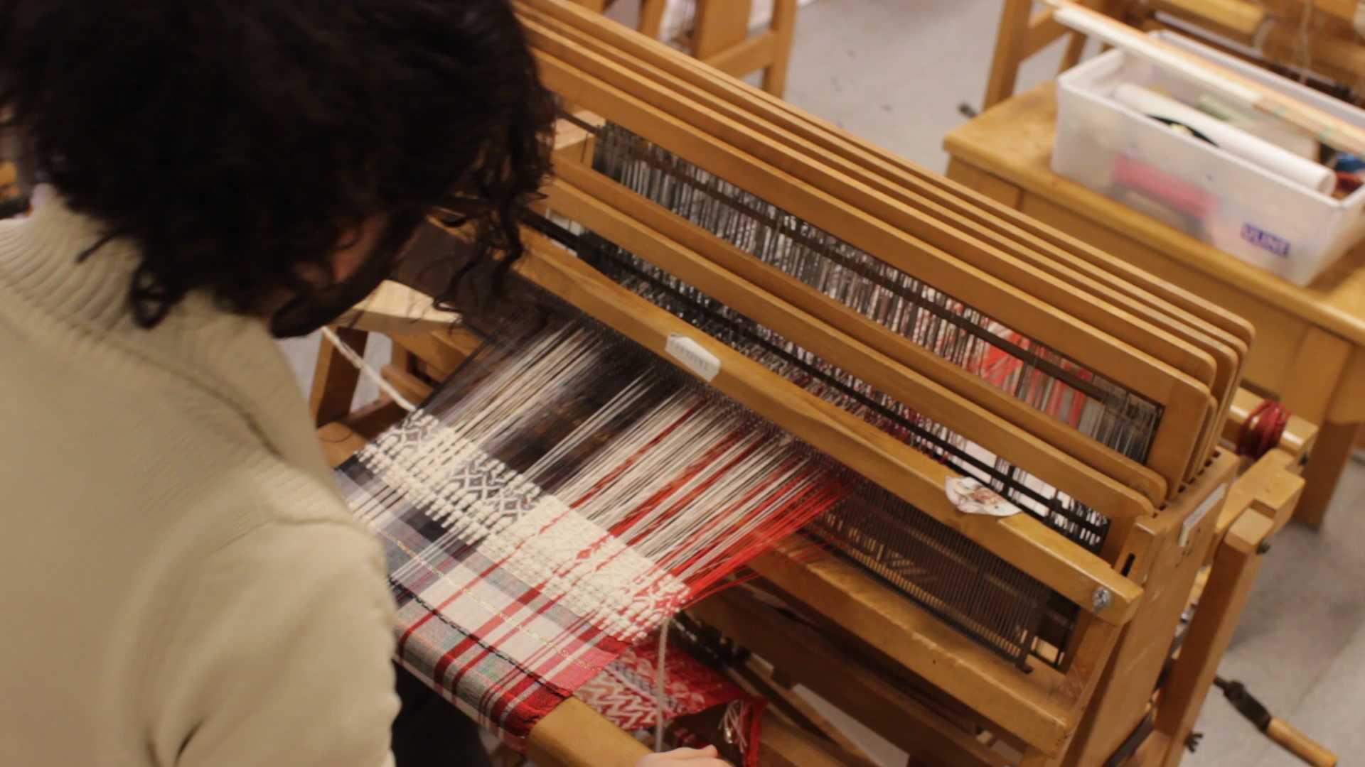Weaver interprets abstract art through his scarves