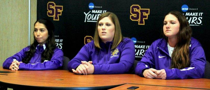 SF State head softball coach Lisa Allen, center, answers Media Day questions with outfielder/pitcher Aryn Guzman, left, and starting pitcher Megan Clark. (Pablo Caballero / Xpress)