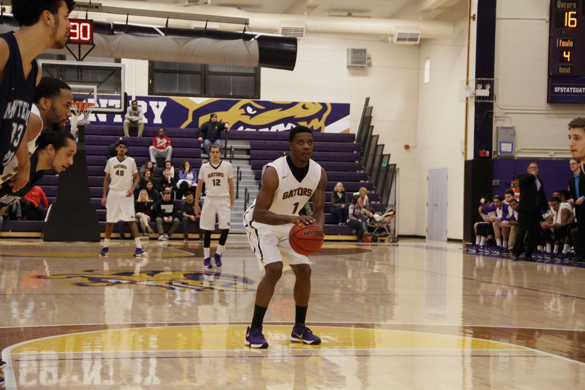 SF State Gator Warren Jackson (1) focuses on making a free throw during the men's basketball game against the Cal State Monterey Bay Otters at The Swamp Saturday, Jan. 23. The Gators won 85-79.