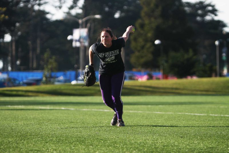 Megan Clark (17) pitches at SF State Gators softball team practice Tuesday, Feb. 2, 2016. The Gators open the season at home with a double-header against Northwest Nazarene University on Feb 12 at 1 p.m. (James Chan / Xpress)