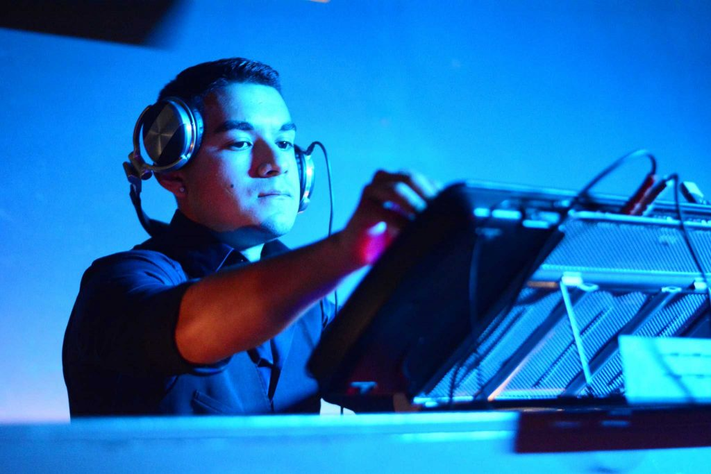 SF State student Gilbert Adam Guillen performs his DJ set at the Horizon Lounge in San Francisco's Financial District, Thursday, January 28, 2016. (Connor Hunt / Xpress)