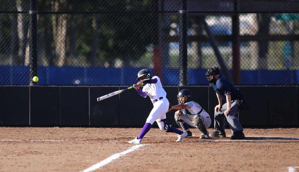 SF State Gators women softball team Madison Collins (13) makes a strike during the second doubleheader softball game against Cal State San Bernardino. SF State won 8-2 over Cal State San Bernardino on Saturday, February 20, 2016. (Perng-chih Huang / Xpress)