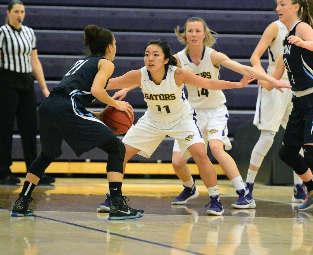 SFSU guards Brooke Shimazaki (11) and Tatsiana Dashkevich (14) play defense against Sonoma State Seawolves Guard Taylor Acosta (21) at The Swamp on February 20, 2016. (Connor Hunt / Xpress)
