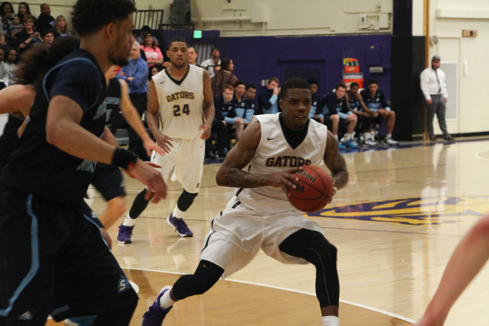 Warren Jackson (1), a guard for the SF State mens basketball team, dribbles the ball away from an opponent of  the Sonoma Seawolves in San Francisco, CA on Saturday, Feb. 20, 2016. Sf State won 80-76. (Alex Kofman / Xpress)