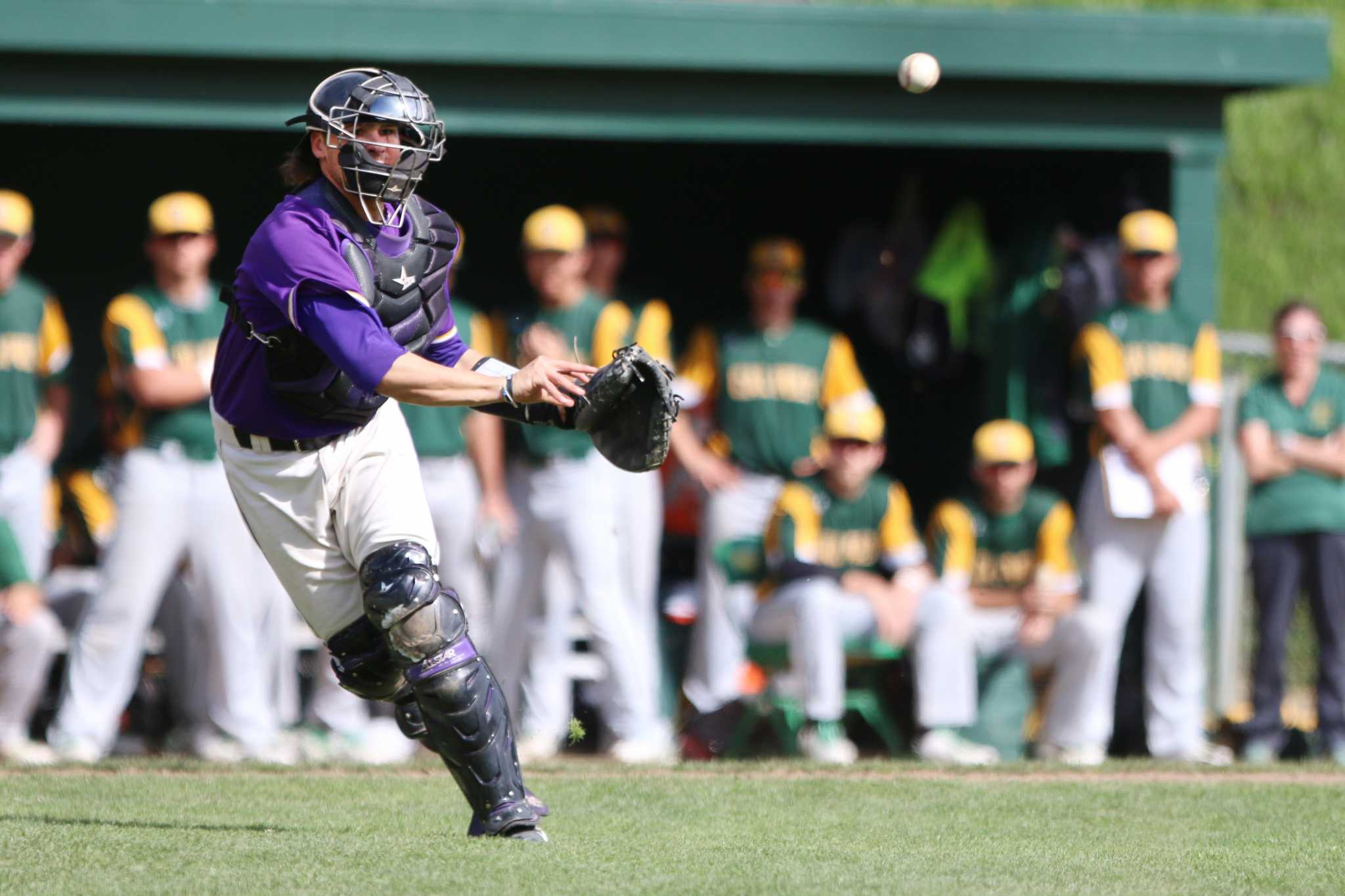 SF State Gator catcher Carter Gambrell (11) throws the ball toward first base for an out during the top of the sixth inning of their 9-4 loss to Cal Poly Pomona at Maloney Field on Sunday, Feb. 28, 2016. (George Morin / Xpress)