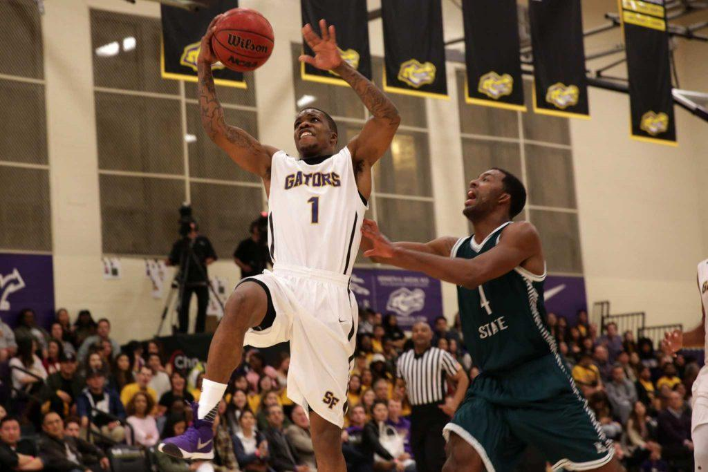 SF State Gators' guard Warren Jackson (1) makes a charge towards the basket in the first half of a game against the Humboldt State Lumberjacks at The Swamp at SF State on Friday, Feb. 5, 2016. The Gators won 85-59.( Ryan McNulty / Xpress )