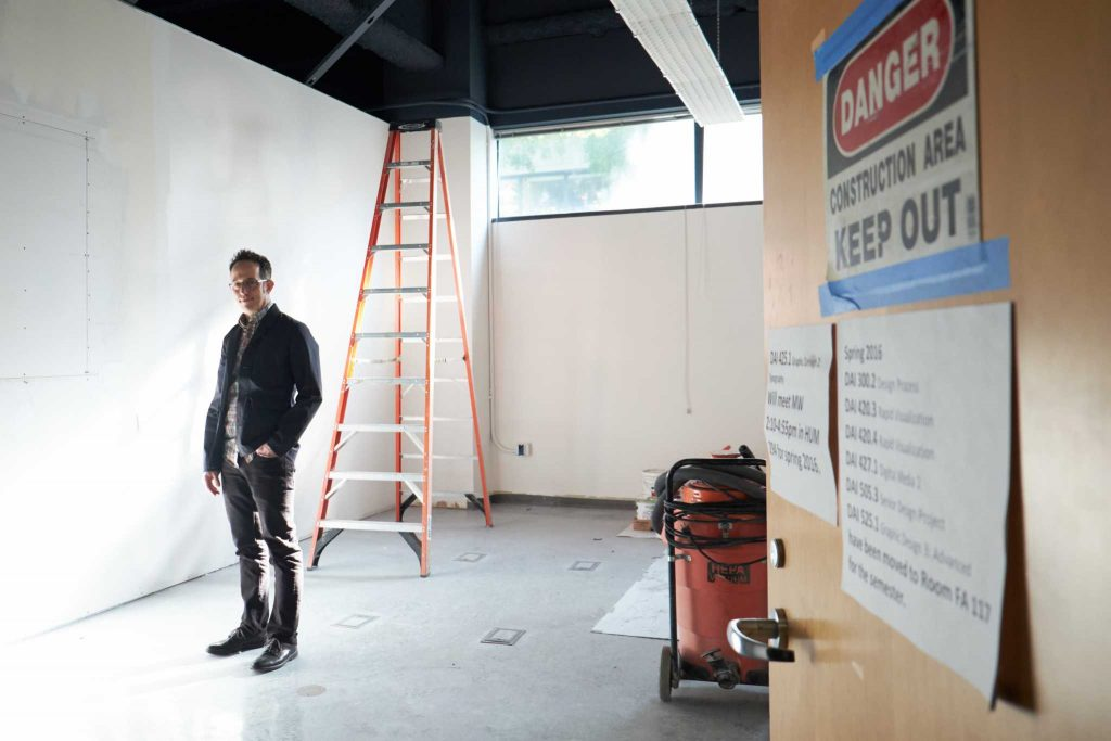 Director+of+the+new+Design+Gallery%2C+Joshua+Singer+stands+in+the+doorway+of+the++exhibition+space+to+be+completed+this+Spring+in+the+Fine+Arts+building.+%28Taylor+Reyes+%2F+Xpress%29