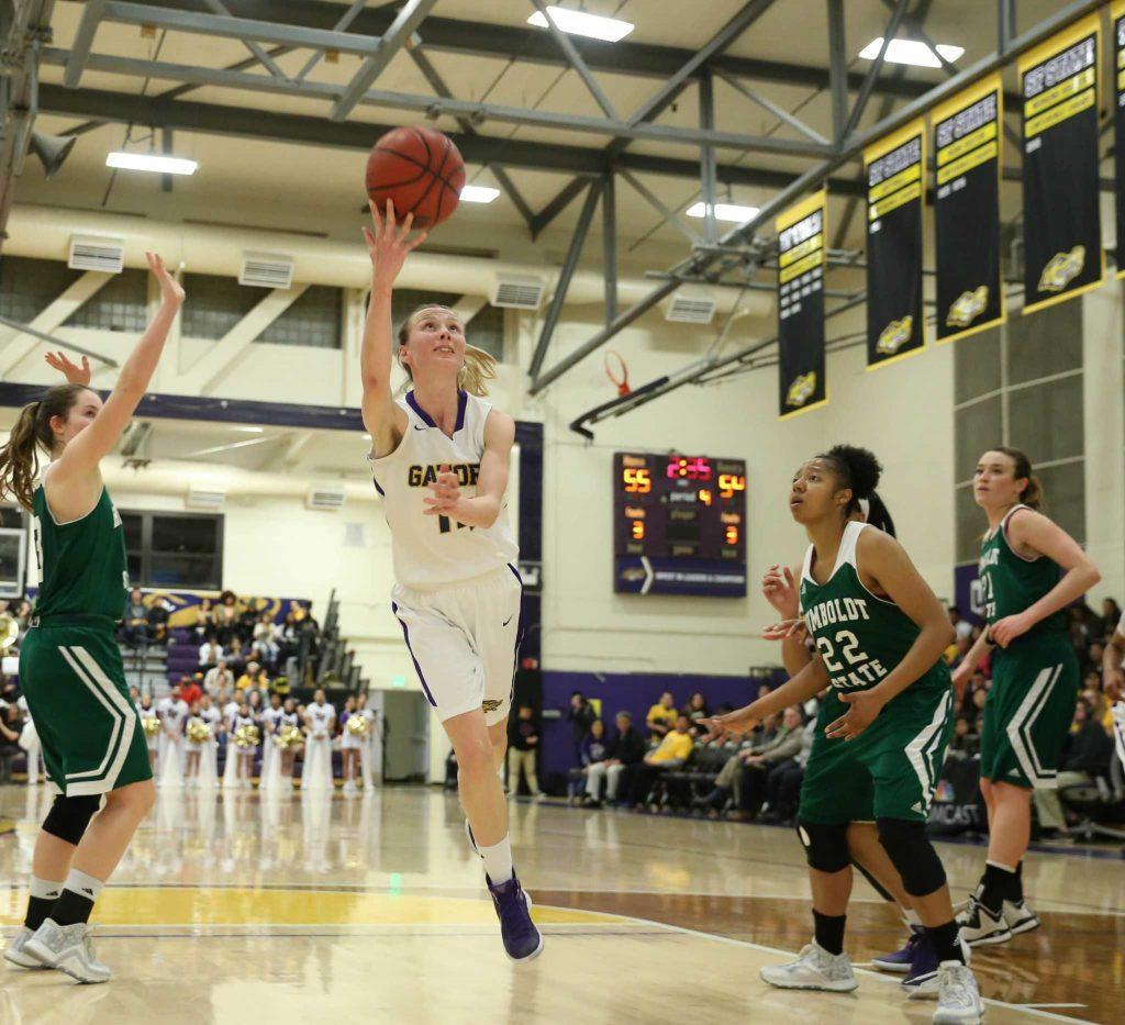 24.	SFSU Gator Tatsiana Dashkevich drives to the basket during their game against the Humboldt Jacks on Friday. Jacks won (Aleah Fajardo/Xpress)