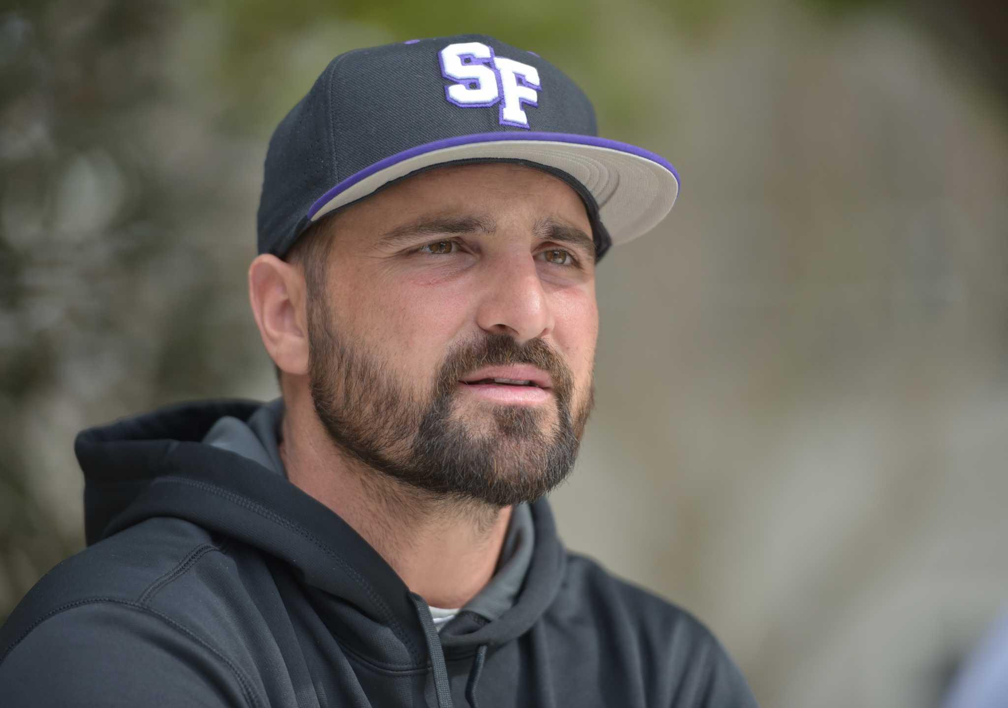 SF State assistant baseball coach Tyler LaTorre talks to Golden Gate Xpress reporter during an interview on SF State campus Thursday, Feb.11. (Qing Huang / Xpress)