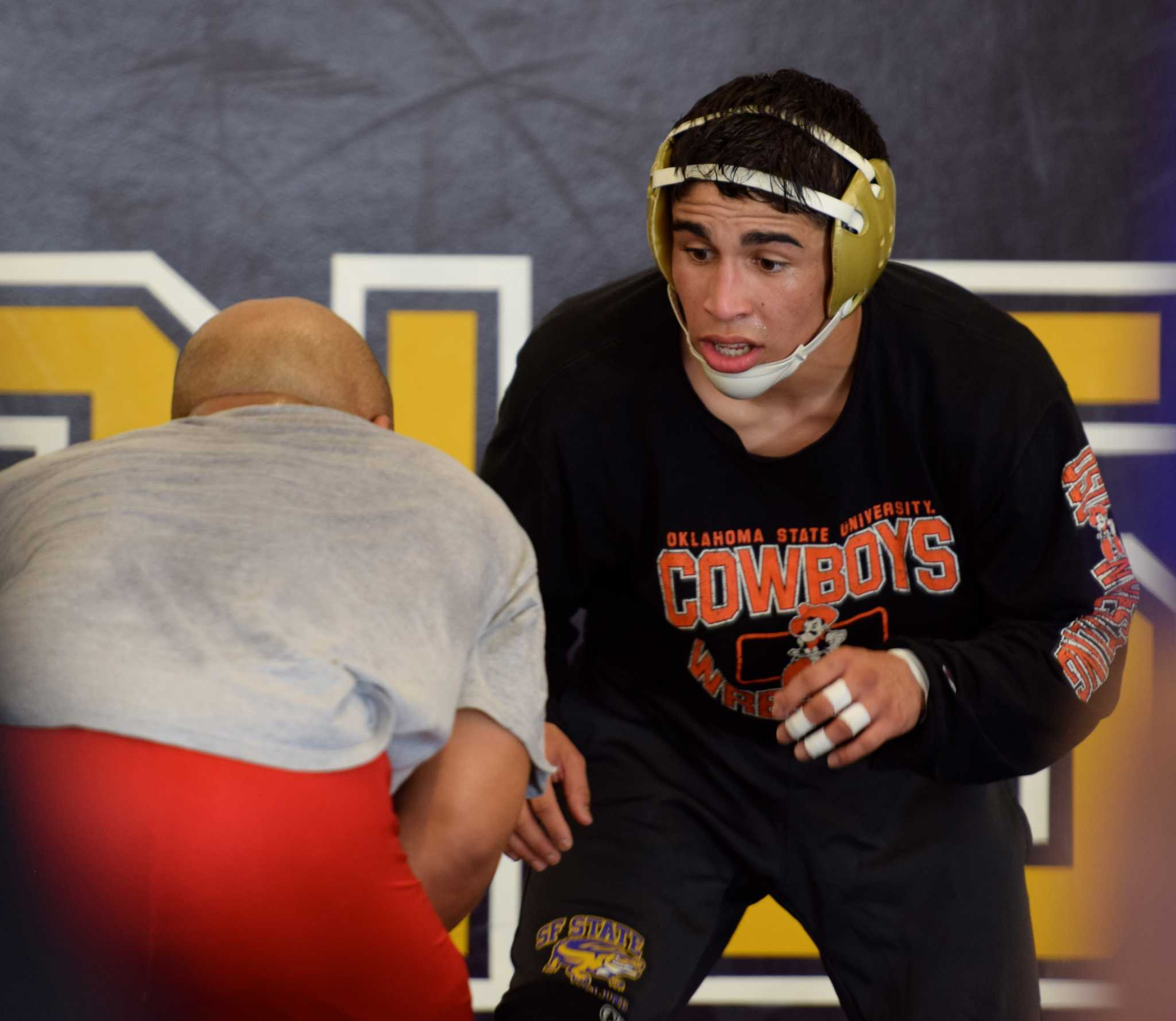 Fern Giron, freshman on the SF State wrestling team at practice preparing for the upcoming NCAA Division II National Wrestling Championships Monday. (Eric Chan / Xpress)