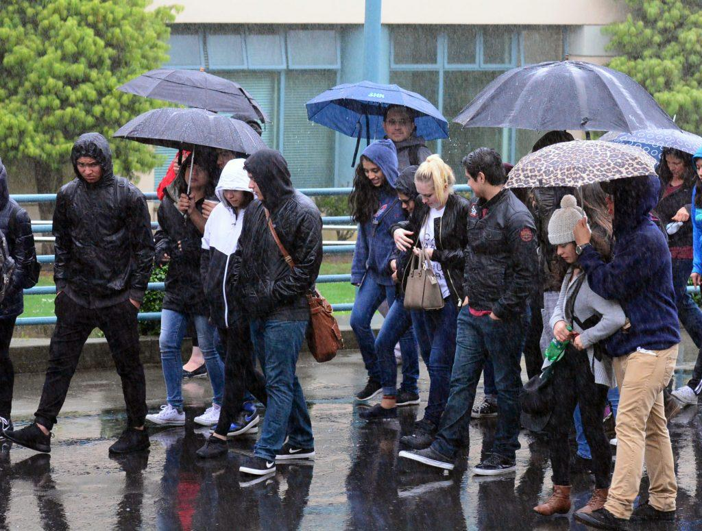 A tour of people are lead through campus during a down pour on Friday, Mar. 4 2016. (Connor Hunt / Xpress)