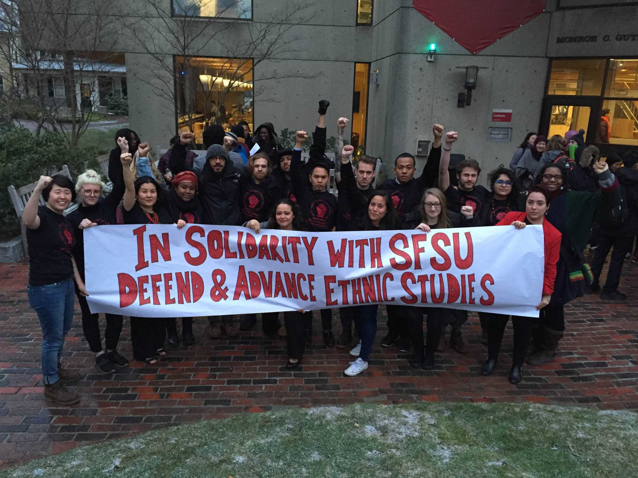 Harvard Graduate School of Education students pose with a banner they made in support of the SF State College of Ethnic Studies. (Photo courtesy of Christina Villarreal)