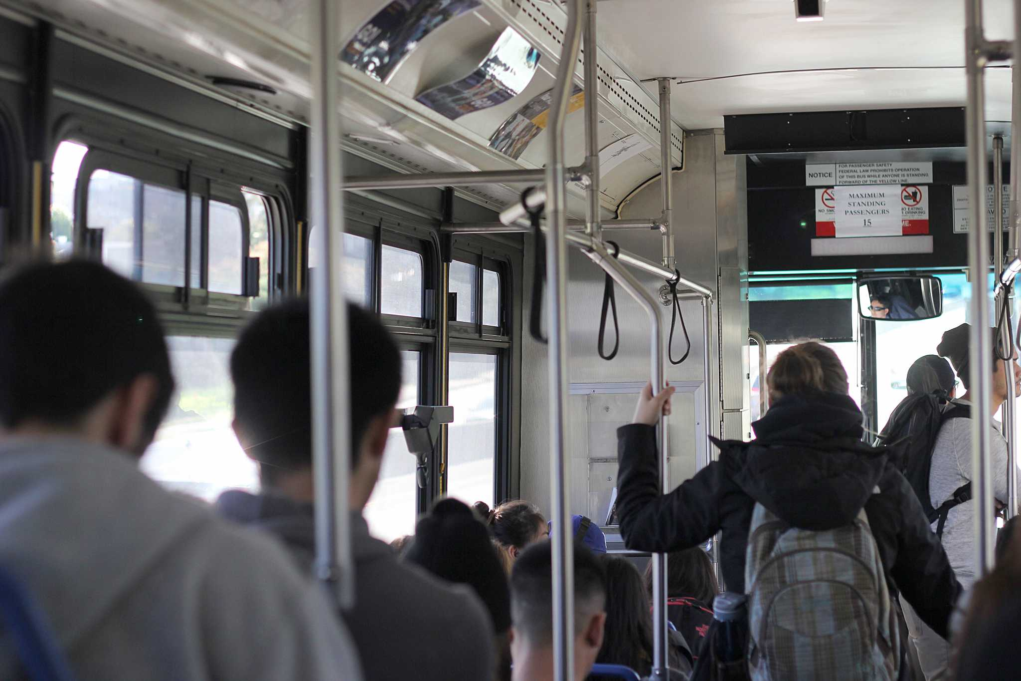 002: Students fill a SF State shuttle bus outside of SF State in San Francisco, Calif on Monday, Feb. 22, 2016. Students have raised safety concerns about the over crowded Muni and college shuttle buses that they take to and from SF State. (George Morin / Xpress)
