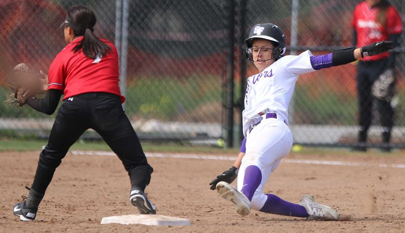 SF State Gators outfielder Alexis Mattos (8) slides safely into second base while Warriors infielder Alexus Martinez (7) waits for the ball during their 4-0 loss to Cal State Stanislaus at SF State on Friday, March 19, 2016. (George Mornin/Xpress)