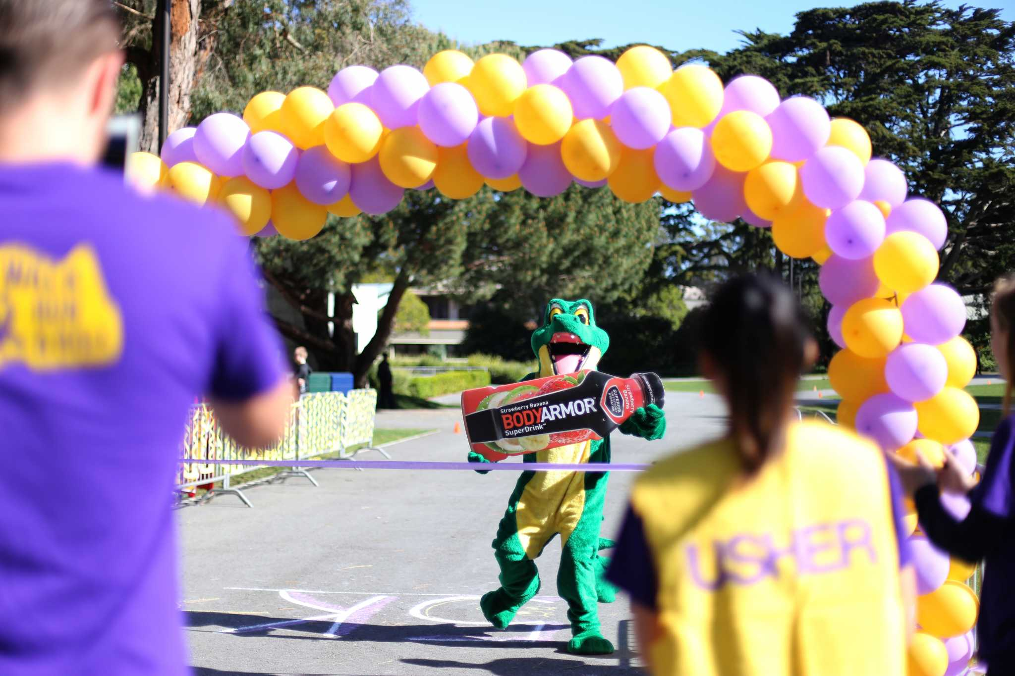 The SF State Gator cheers at the finish line of the 5K Run Roll Walk, Sunday, April 24, 2016. (Perng-chih Huang/Xpress)