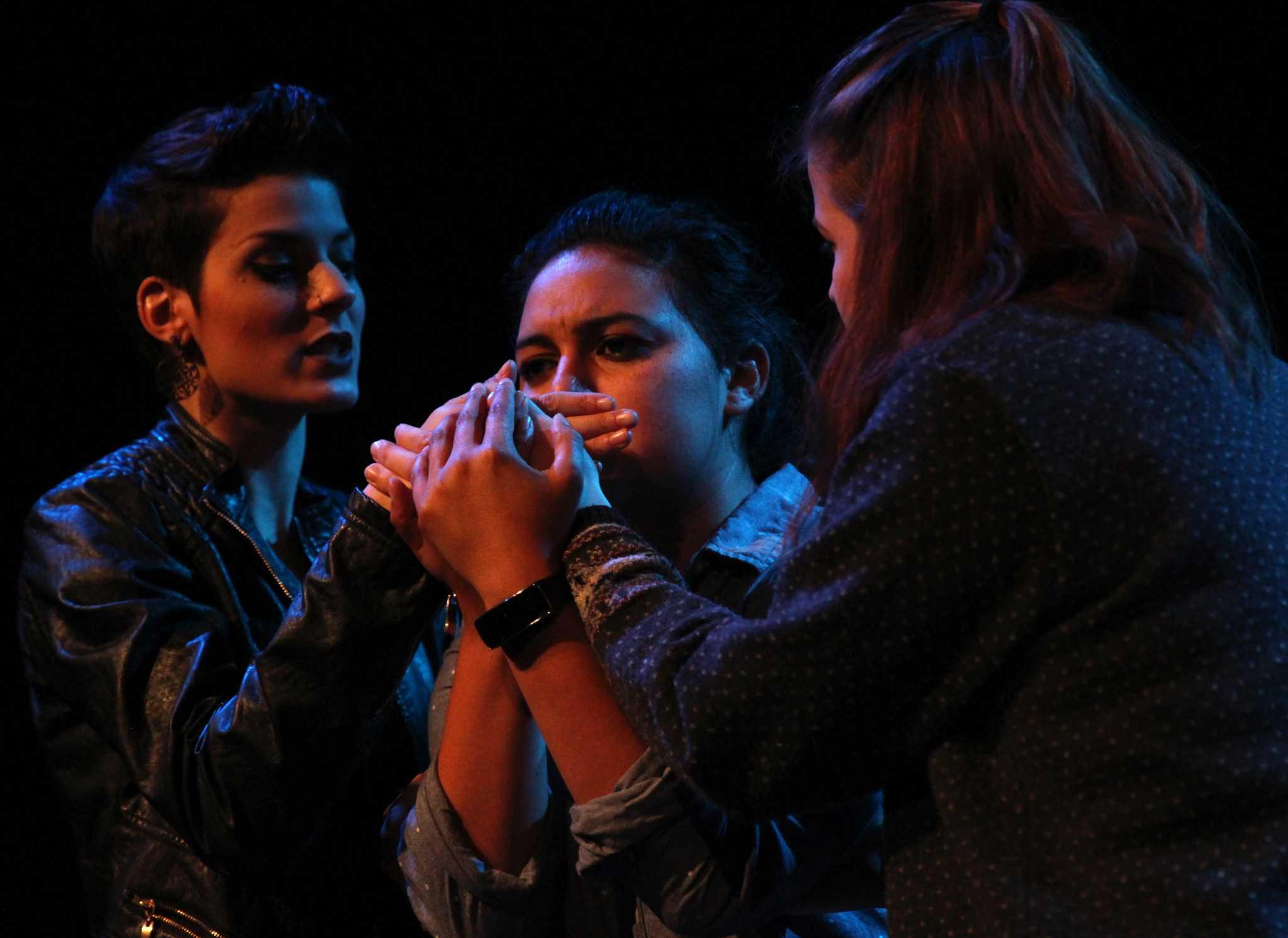 Theater art students Desiree Juanes (left) portraying