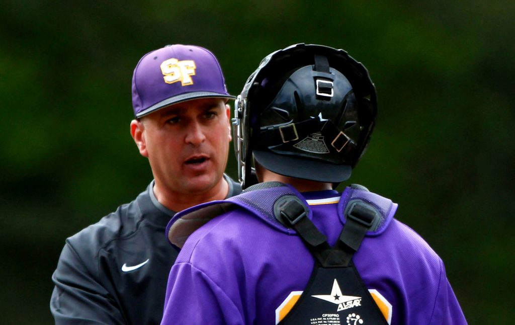 Tony Schifano, head coach of the SF State Gators mens baseball team, speaks strategy with catcher, Dalton Pizzuti (29), during a game against the Monterey Bay Otters in which SF State lost  0-7 in San Franicsco, Ca on Saturday, Mar. 19, 2016. (Alex Koffman / Xpress)