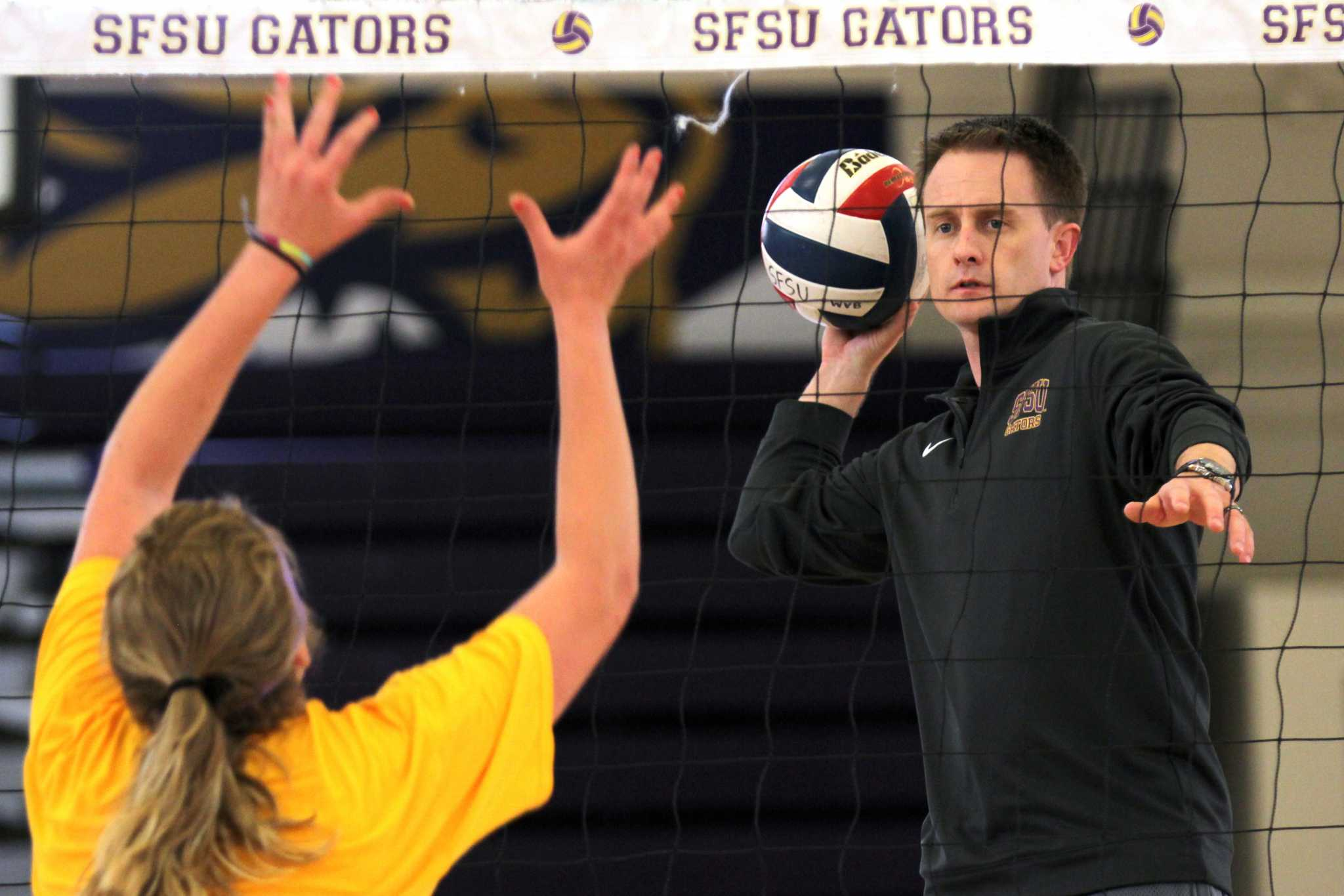 SF State Gators volleyball head coach Matt Hoffman runs drills with the team in The Swamp on Thursday, April 7, 2016. Hoffman was announced as the new volleyball coach on Tuesday, March 29, 2016.