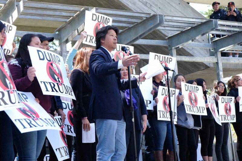Tom Hsieh rallies democratic support from the crowd at SF State by chanting