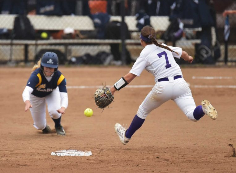 UC San Diego Tritons second base Darian Van Der Maaten (13) slides into second base against SF State Gators infielder Jennifer Lewis (7) during the first game of a doubleheader at the SFSU softball field Friday, Apr.8. Gator won 2-0. (Qing Huang / Xpress)
