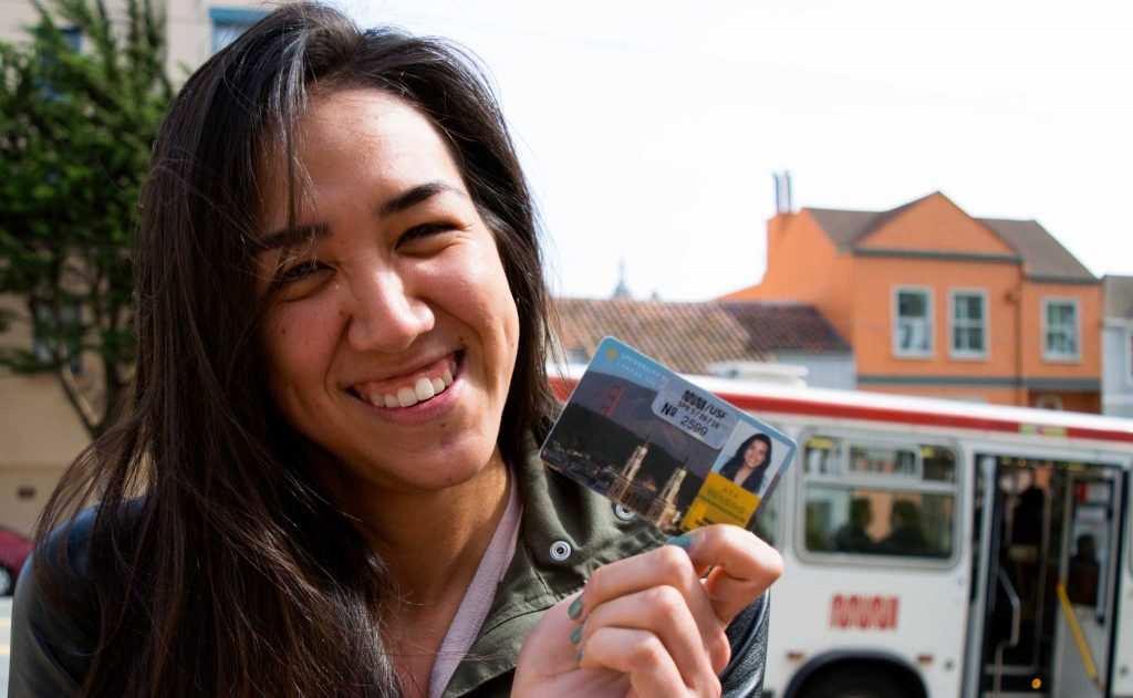 USF student Aya Bensing shows her Muni transit pass from USF at a USF campus bus stop on Mon. May 2, 2016. (Gabriela Rodriguez / Xpress)