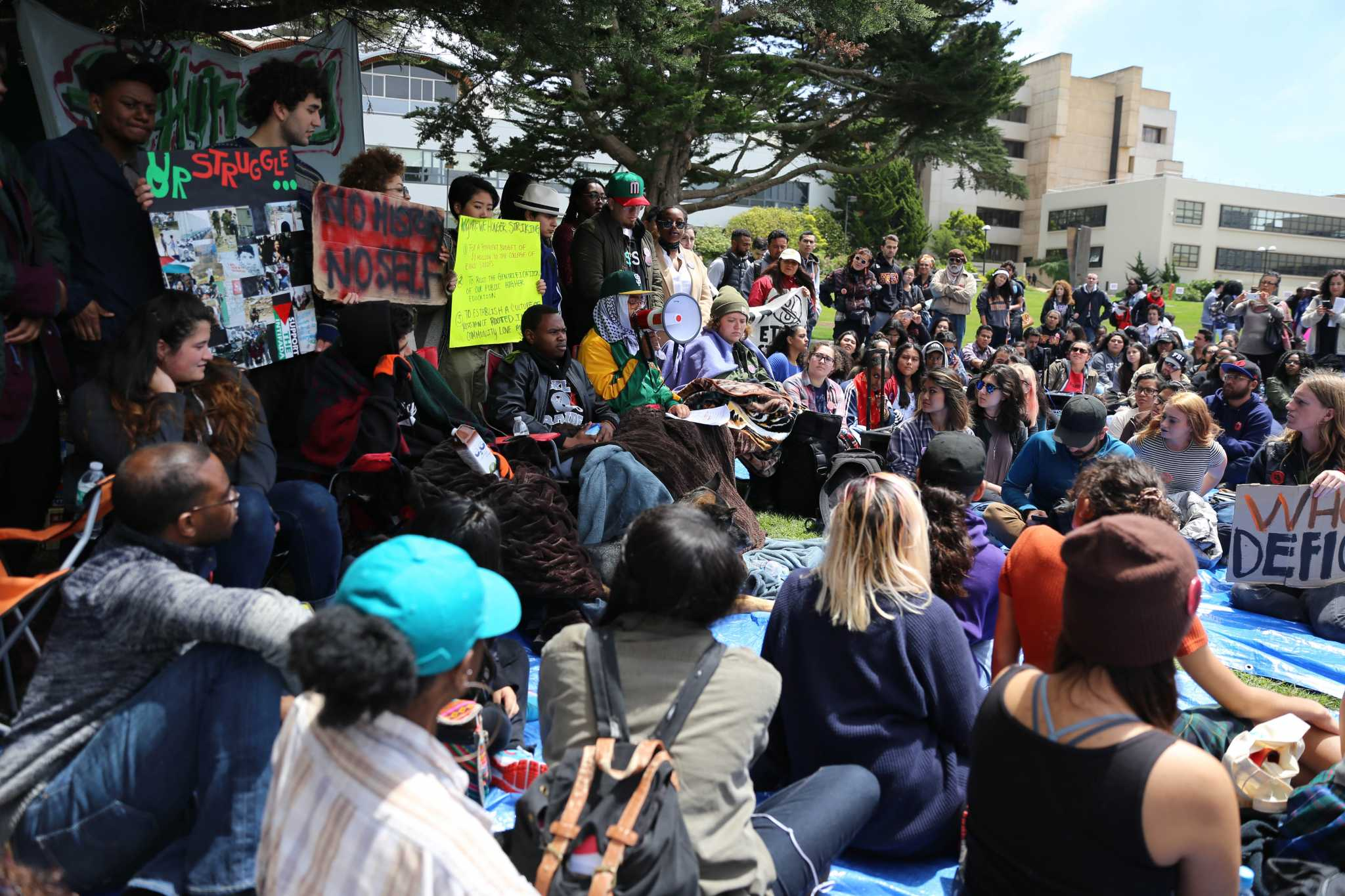 Students and faculty gather in the quad for a press conference regarding demands for SF State, President Wong on the eighth day of the  hunger strike on Monday.  The hungerstrike is led by the Third World Liberation Front 2016, a name used to pay homeage to the 1968 strike.  (Aleah Fajardo/ Xpress)