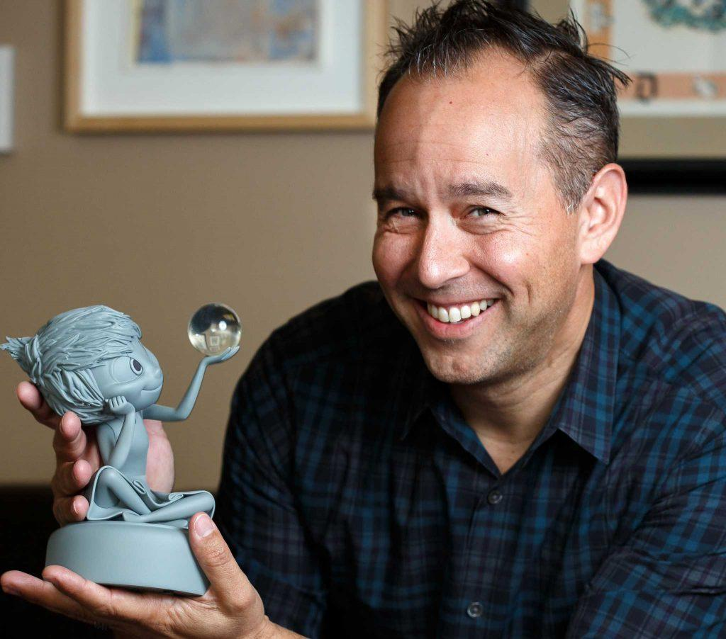 Jonas Rivera poses for a portrait with models of some of the characters from movies he has worked on at Pixar in Emeryville on Friday, May 13, 2016. Rivera recently won an Oscar as executive producer for the movie Inside Out and is an SF State alumni. ( Ryan McNulty / Xpress )