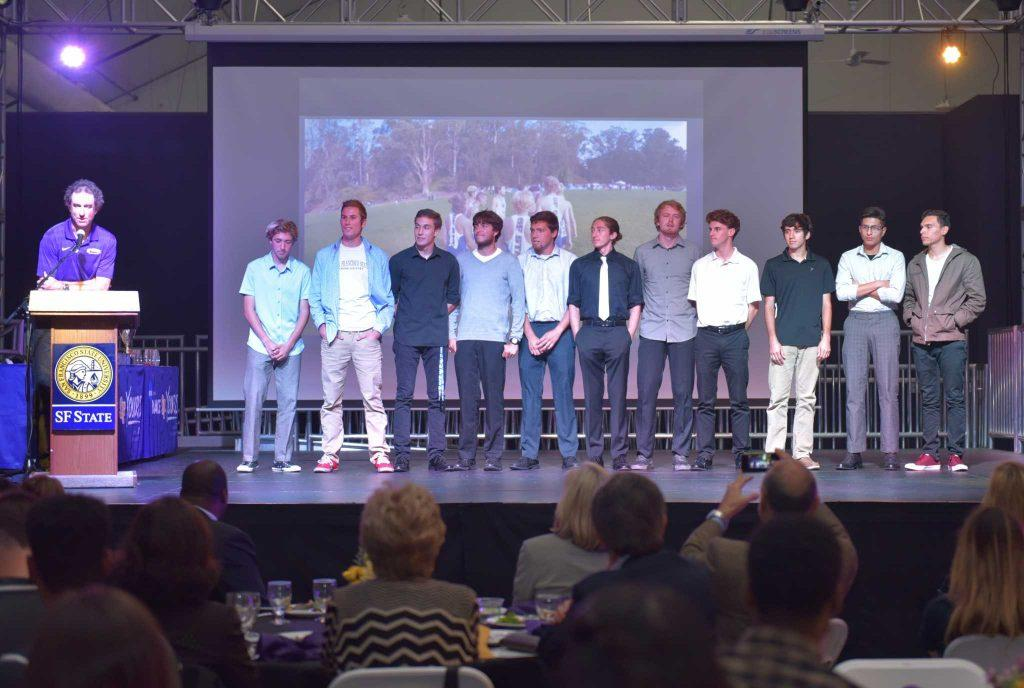 SF State men's cross country team stand on the stage during student athlete awards banquet at SF State Student Event Center Tuesday, May.10. (Qing Huang/Xpress)