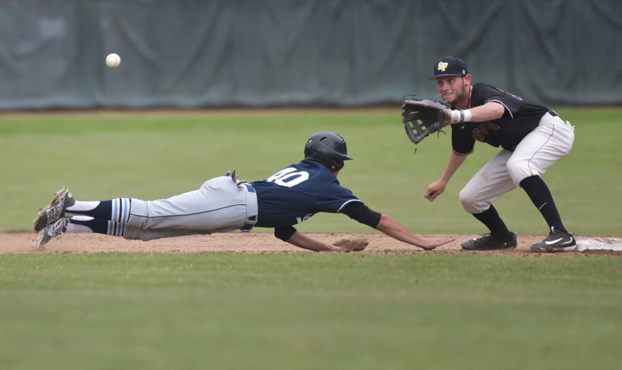 SF State Gators infielder Bryce Brooks (39) tries to tag as Sonoma State Seawolves outfielder Bryant Cid (40) slides back to second base during the game in Gator's 4-11 loss at SF State's baseball field Friday, May 6. (Qing Huang/Xpress)