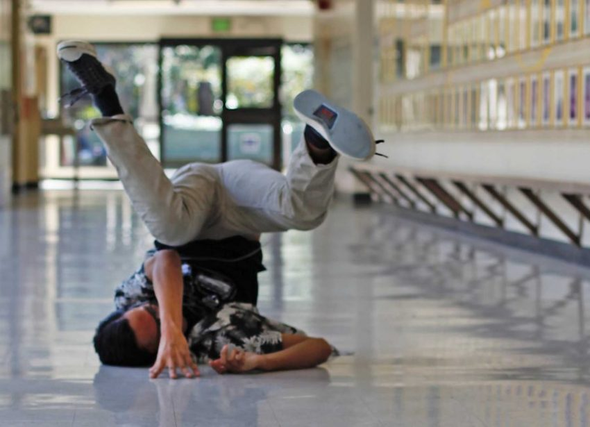 SF State student Jordon Acaero strikes a pose in the hallway of the gym on Monday, Sept. 19, 2016. An unnamed breakdance group have turned a corner of the gym building into their own hub of music, dance and hip hop.