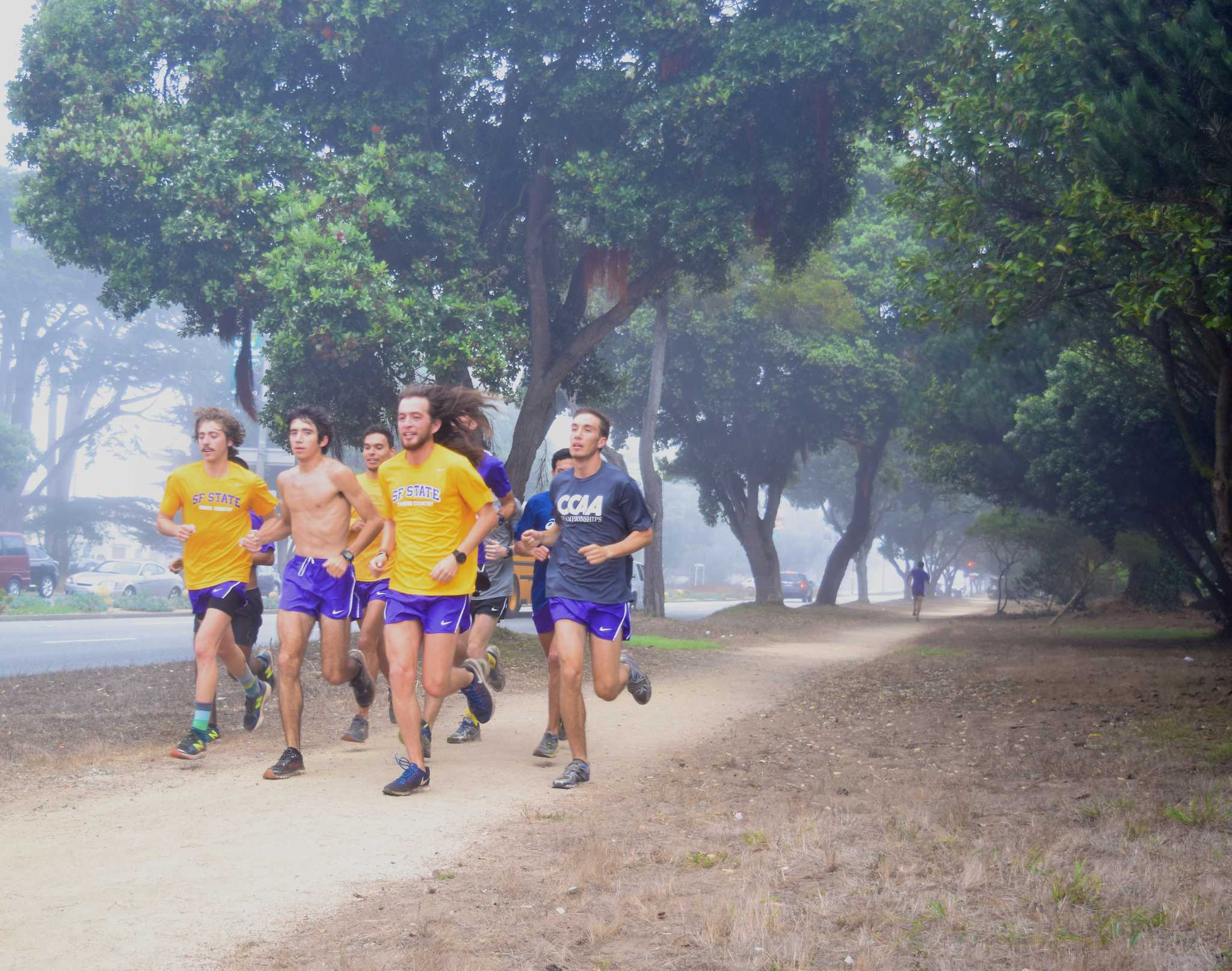 The SF State Cross Country team runs down a trail near Sunset Boulevard on Tuesday, Sept. 27, 2016