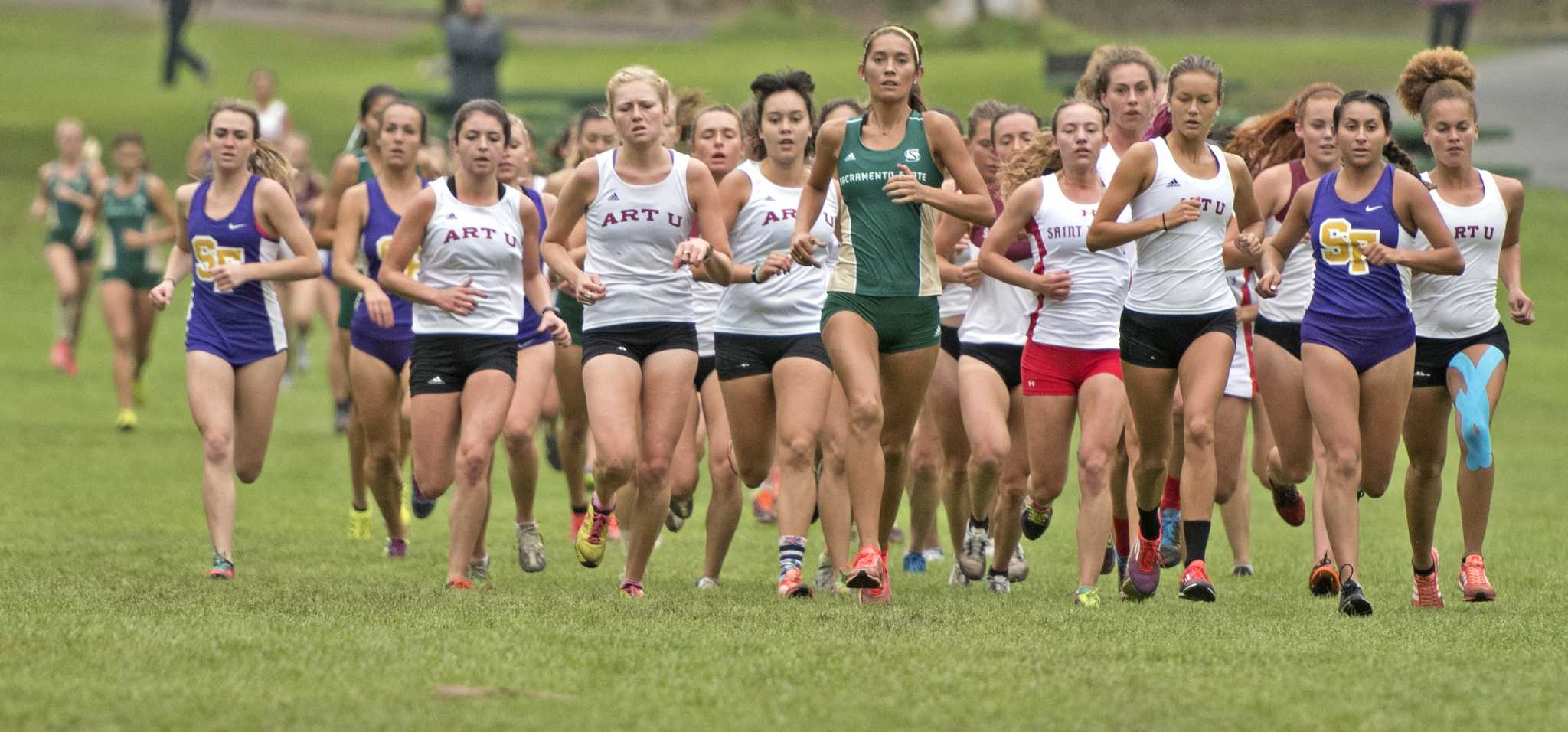 SF State Gators' junior Magali Arsiniega (second right) leads the race during the first loop of the 5800 meter race at Hellman Hallow Meadow in Golden Gate Park on Thursday, Sept. 15, 2016. Arsiniega finished the race in 14 place with a time of 23:00.00.