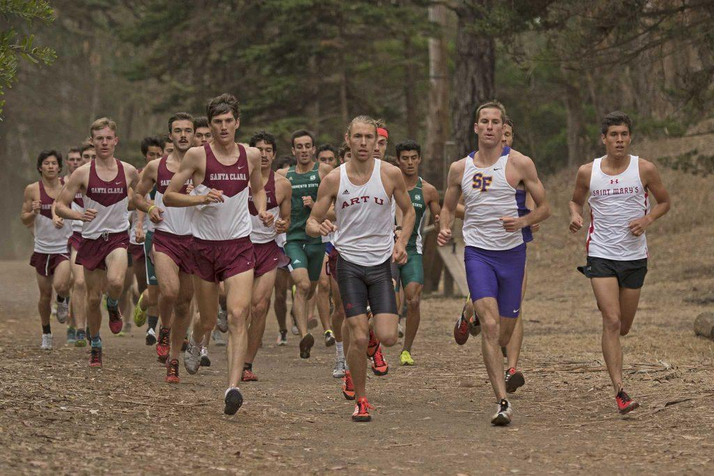 SF State Gators' junior Drew Feldman leads the race during the second loop of the 7250 meter race at Hellman Hallow Meadow in Golden Gate Park on Thursday, Sept. 15, 2016. Feldman finished the race in 4th place with a time of 23:18.00.