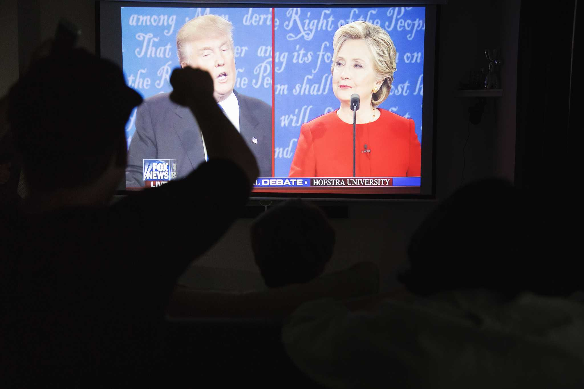 Members of SF State republican student union watch the first presidential debate between Donald Trump and Hillary Clinton in a house at Parkmerced on Monday, Sept. 26, 2016.