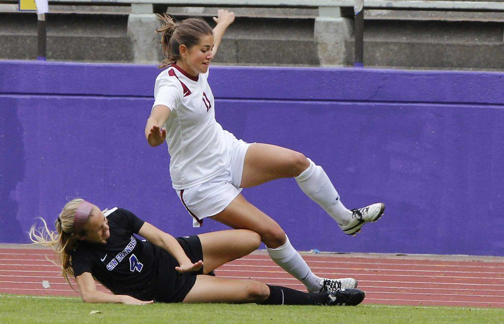 SF State Gators' senior forward Autumn Fox (4) slide tackles a Wildcat player during their 2-1 loss against Central Washington University at Cox Stadium on Thursday, Sept. 1, 2016. (Brenna Cruz/Xpress)