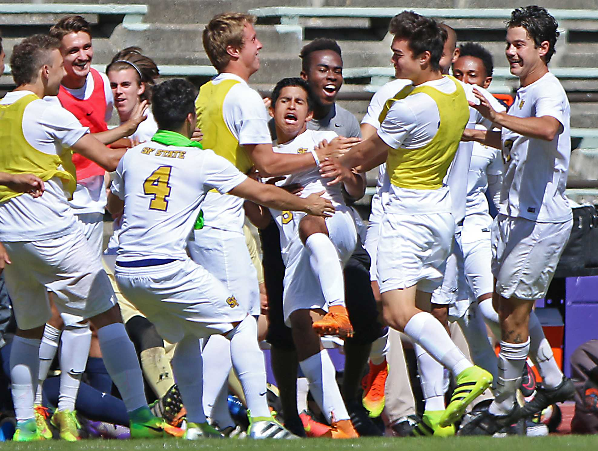 SF State Gators' players celebrate freshman forward Richard Leon's (8) golden goal during their 3-2 overtime win over Cal State Monterey Bay at Cox Stadium on Wednesday, Sept. 14, 2016. (George Morin/Xpress)