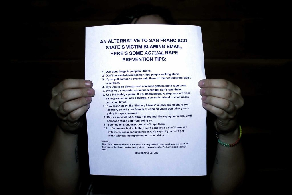 The author of the anonymous letter mocking SF State's campuswide email about Title IX efforts stands with their letter in their home in San Francisco on Monday, Sept. 19, 2016. The SF student explained their reasoning behind writing the letter in an interview with the Golden Gate Xpress.