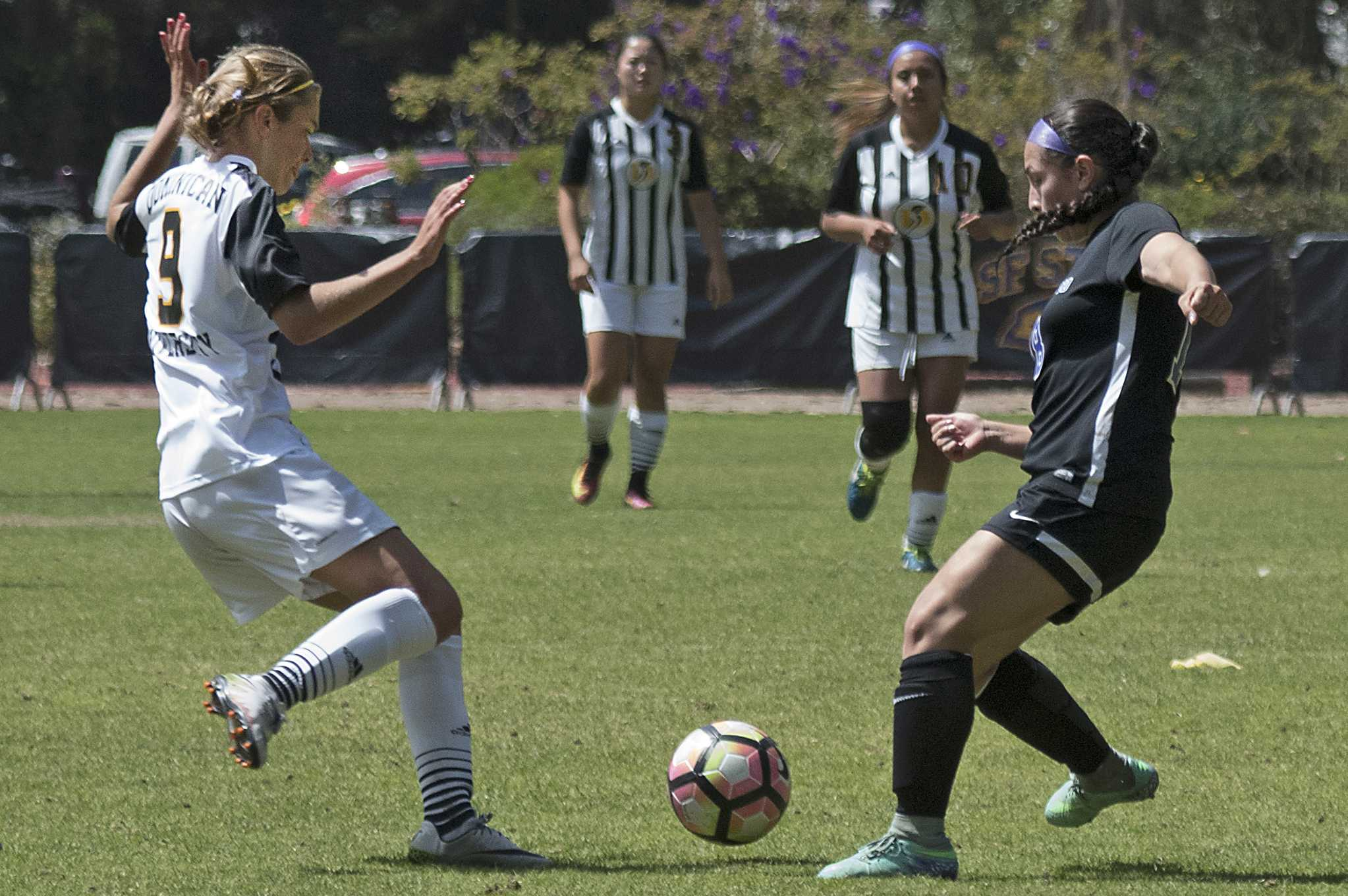 SF State Gators' freshman defender Valentina Riveros (18) prepares to clear the ball during their 2-2 double overtime tie against Dominican University of California at Cox Stadium on Sunday, Sept. 4, 2016.