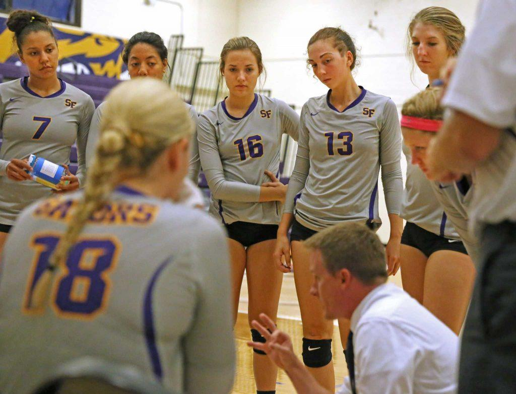 SF State Gators' head coach Matt Hoffman talks with his team during their loss against Sonoma State University at the Swamp on Saturday, Sept. 17, 2016. The Gators fell to the Seawolves in three straight sets.