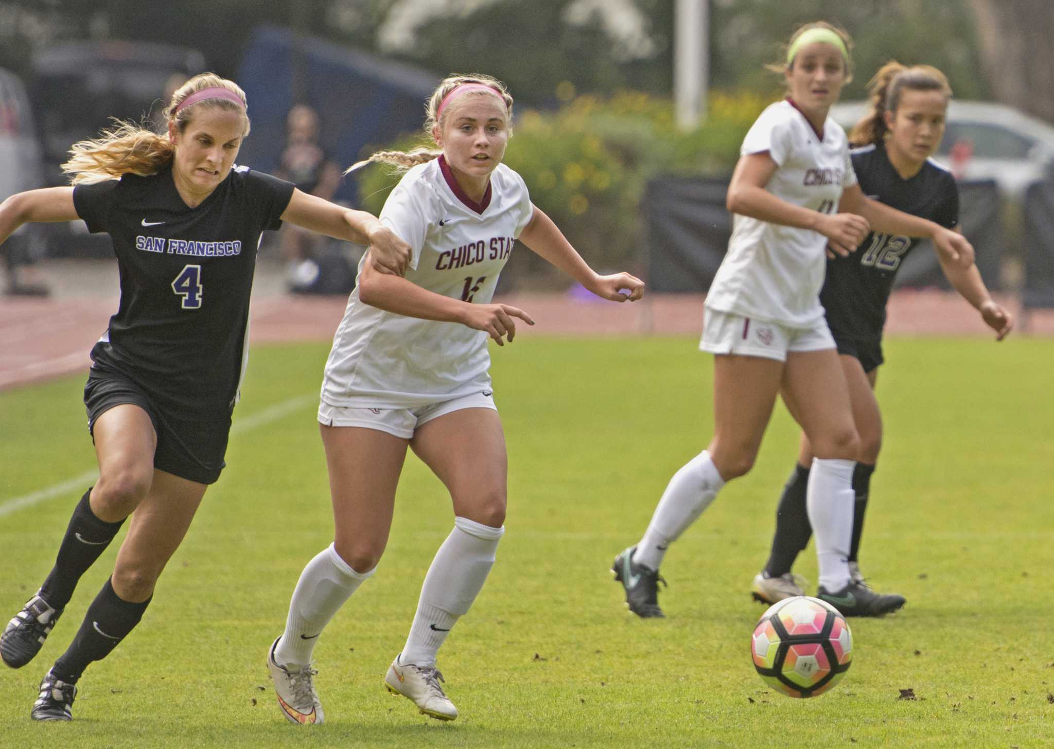 SF State Gators' senior forward Autumn Fox (4) breaks through the Wildcats' defense during their 2-1 win over Chico State University at Cox Stadium on Friday, Sept. 16, 2016.